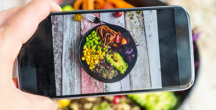 a restaurant owner taking a menu photo using food photography tips from Grubhub