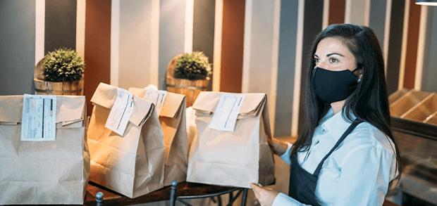 Restaurant employee preparing virtual restaurant orders
