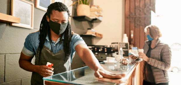 restaurant worker following new indoor dining procedures