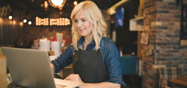 restaurant owner working on her digital restaurant marketing strategy