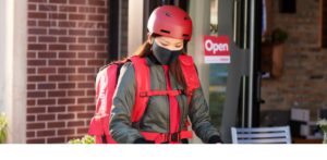 Grubhub delivery driver completing a contact-free delivery order