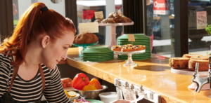 a restaurant employee checking Grubhub orders