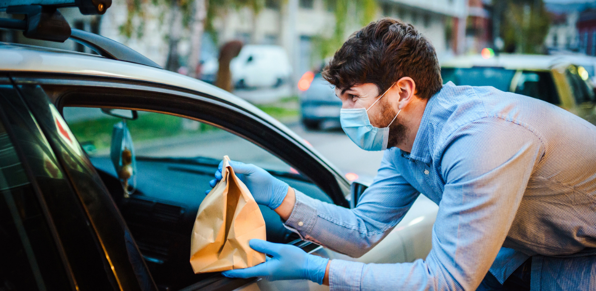 Grubhub restaurant partner handing off a curbside pickup order