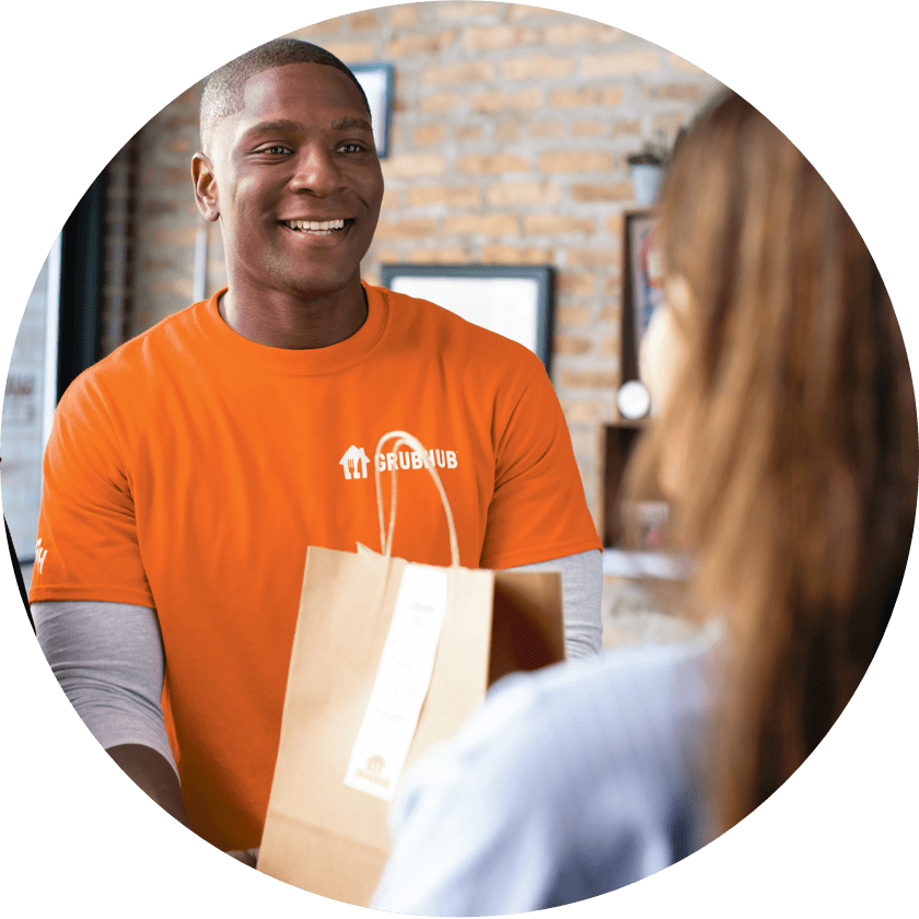 Grubhub delivery driver picking up an order from a restaurant