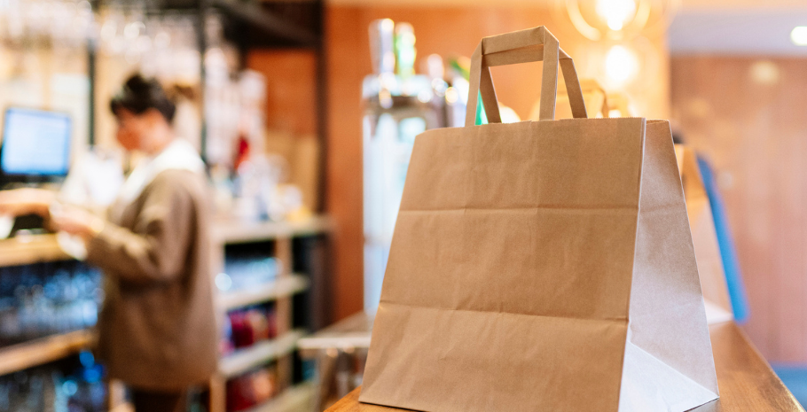 a takeout bag waiting for the restaurant delivery driver to pick it up